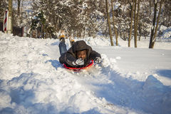 Man sledding Stock Images
