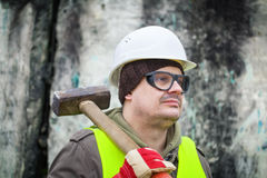 Man with sledge-hammer Stock Photo