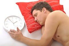 Man sleep with clock Stock Photos