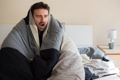 Man with sleep problem in his bed at home. Man with sleep disorder lying in the bed stock images