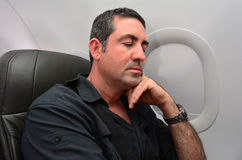 Man sleep during flight. Aboard a jetliner airplane Royalty Free Stock Photography