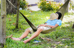 Man sleep in a hammock. Young man sleep in a hammock Stock Photography