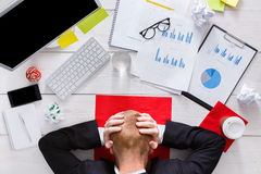 Man sleep on laptop. At office with cup Stock Photo