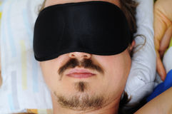 Man with sleep mask Royalty Free Stock Images
