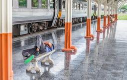 Man sleep in Passenger platform at  the railway station Royalty Free Stock Photography