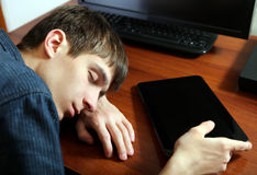 Man sleep with Tablet Computer Royalty Free Stock Photo