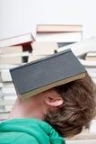 Man sleeping. A man sleeping behind a book stock photo