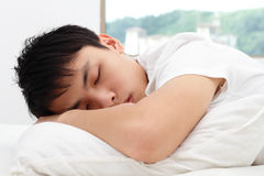 Man sleeping. An Asian man sleeping on a bed Royalty Free Stock Photography