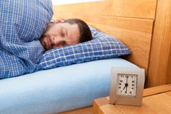 Man sleeping. Young man sleeping in his bed Royalty Free Stock Images