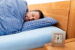 Man sleeping. Young man sleeping in his bed Stock Photography