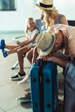 Man sleeping at airport. Selective focus of men sleeping on baggage while waiting for boarding with family at airport royalty free stock photos