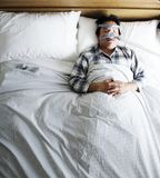 Man sleeping with an anti-snoring mask Stock Photography