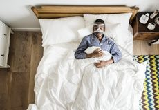 Man sleeping with an anti-snoring mask Royalty Free Stock Photo