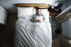 Man sleeping with an anti-snoring mask Royalty Free Stock Photography