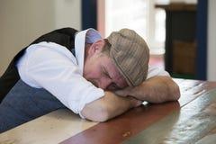 Free Man Sleeping At Table Royalty Free Stock Images - 54905999