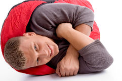 Man in sleeping bag lying Stock Photo
