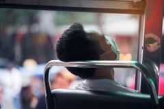 Man sleeping after be tried from hard work in public omnibus of stock image