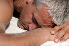 Man sleeping on a beach. Close-up portrait of mature man sleeping on a beach Royalty Free Stock Photo