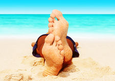 Man sleeping on the beach Royalty Free Stock Images