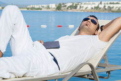 Man sleeping on the beach Royalty Free Stock Image