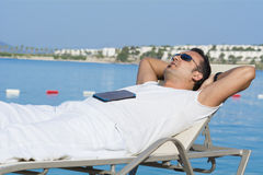 Man sleeping on the beach Royalty Free Stock Photo