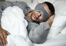 A man sleeping on a bed Stock Images