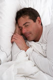 Man Sleeping In Bed Royalty Free Stock Images