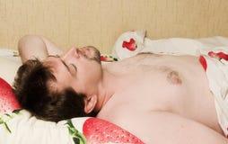 Man sleeping in bed Stock Photos