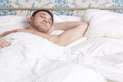 Man sleeping in bed Royalty Free Stock Photography