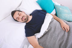 Man sleeping on bed. Stock Photography