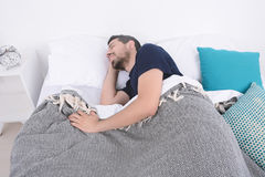 Man sleeping on bed. Close-up of attractive young man sleeping on her bed. Indoors Royalty Free Stock Photos