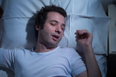 Man sleeping bed royalty free stock photography