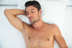 Man sleeping in the bed at home Stock Photography