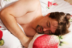 Man sleeping in bed Royalty Free Stock Photo