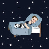 Man sleeping in bed pillow together with puppies dreaming in blue stars Stock Images