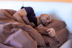 Man sleeping on bed Royalty Free Stock Photos