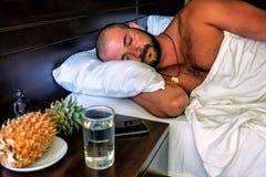 Man sleeping in bed stock image