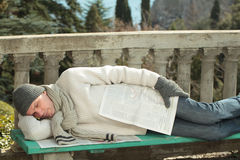 Man sleeping on a bench Royalty Free Stock Photo