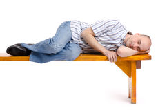 Man sleeping on a bench. Isolated on white Stock Image