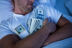 Man Sleeping With Bundle Of Currency Notes Royalty Free Stock Image