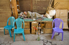 Man sleeping in cairo souk in egypt Royalty Free Stock Photo