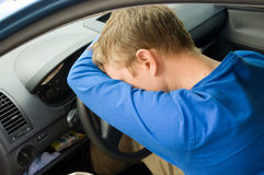 Man sleeping in car Stock Photo