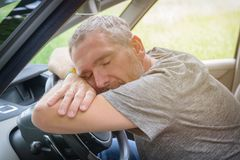Man sleeping in the car Royalty Free Stock Images