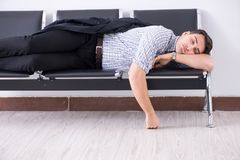 The man sleeping on the chairs in airport. Man sleeping on the chairs in airport stock photography