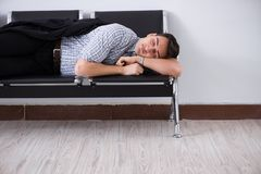 The man sleeping on the chairs in airport. Man sleeping on the chairs in airport royalty free stock image