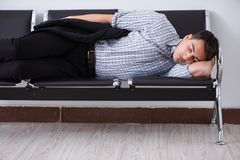 The man sleeping on the chairs in airport. Man sleeping on the chairs in airport stock photo