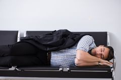The man sleeping on the chairs in airport. Man sleeping on the chairs in airport royalty free stock photo