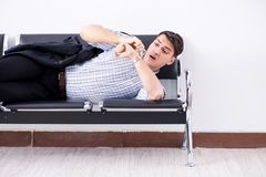 The man sleeping on the chairs in airport. Man sleeping on the chairs in airport stock image
