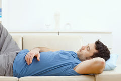 Man sleeping on couch Stock Photo