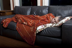 Man sleeping on couch Royalty Free Stock Images